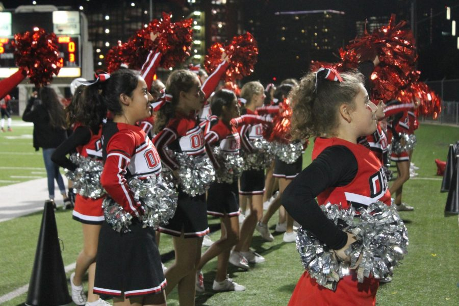 O. Henry cheerleaders perform at a football game
