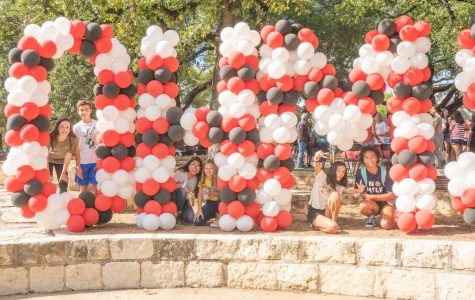 Students pose around the balloon display at the entrance to Round-Up.